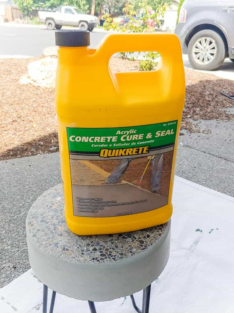 Seal solution in a yellow container placed on top of the diy concrete table