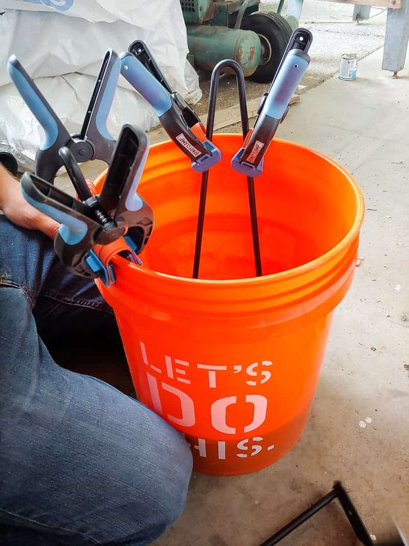 Hair pins legs clipped onto the bucket dipped in the concrete mix.