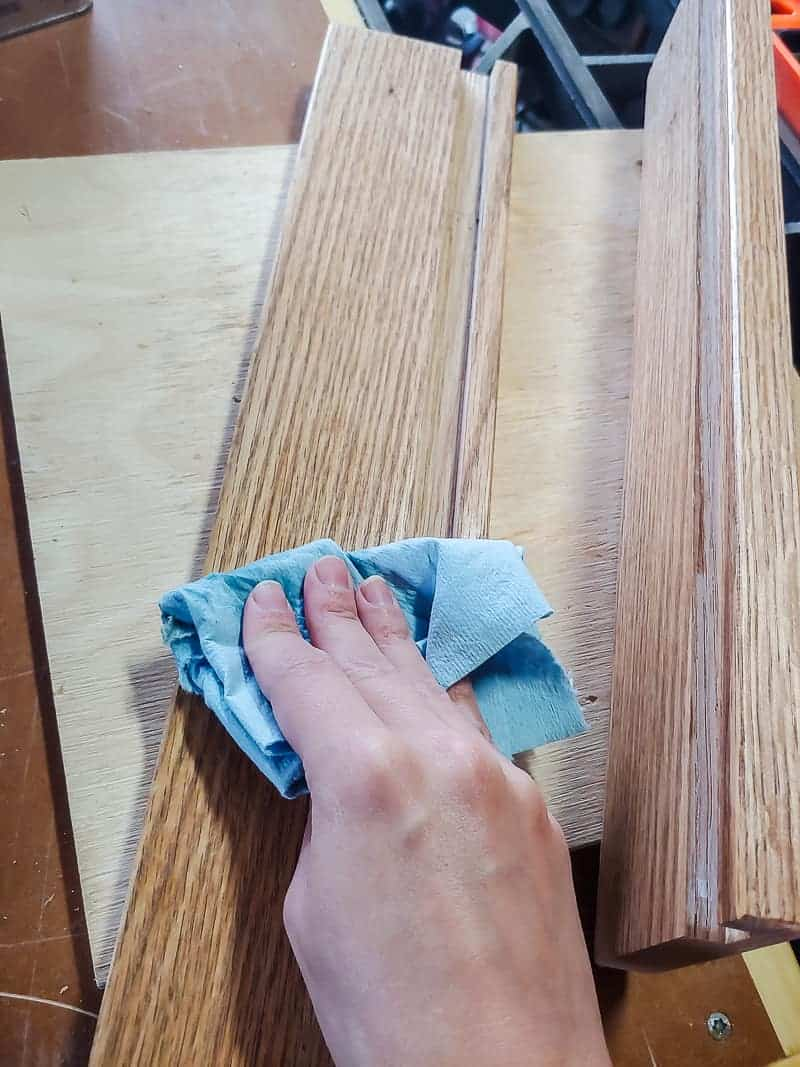 Sanding wood pieces using grit sand paper