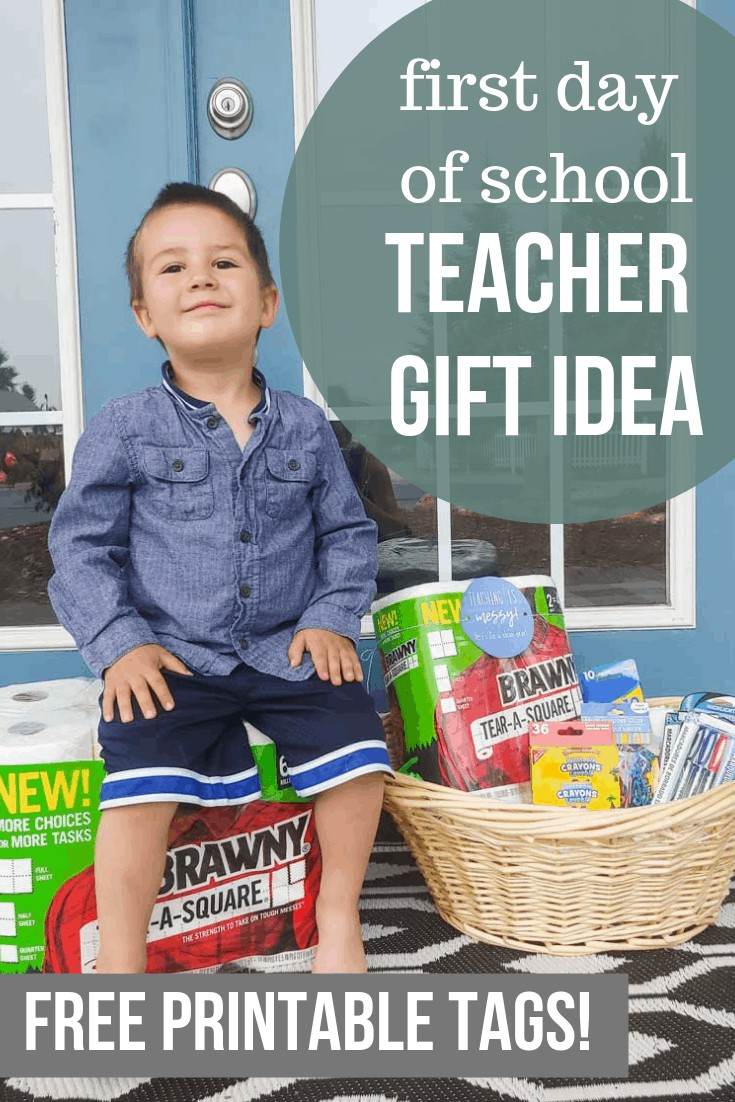 Preschooler boy sitting on top of a tissue paper packs with a teacher gift basket with text overlay that says First Day of School Teacher Gift Idea Free Printable Tags!