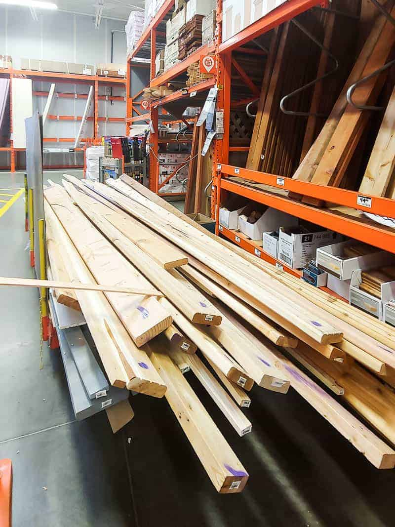Pile of lumber in the cull lumber section at Home Depot for the DIY planter box.