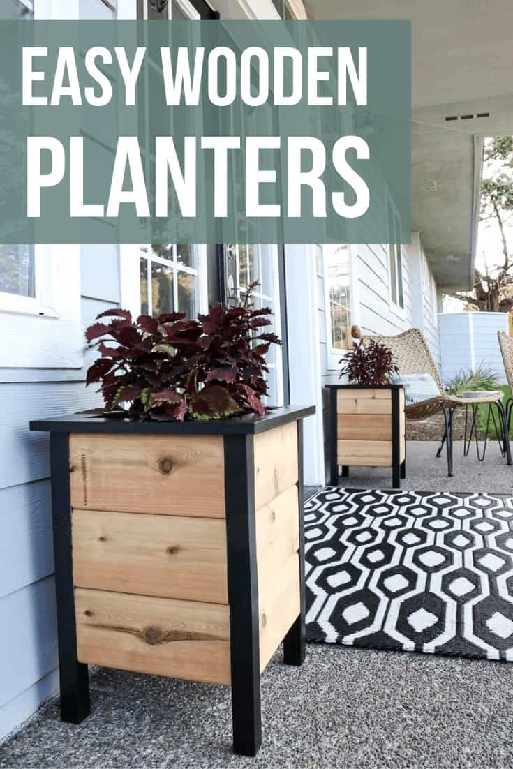 Black painted and cedar planters sitting on front porch on each side of french doors with black and white outdoor rug sitting in front of doors with text overlay that says easy wooden planters