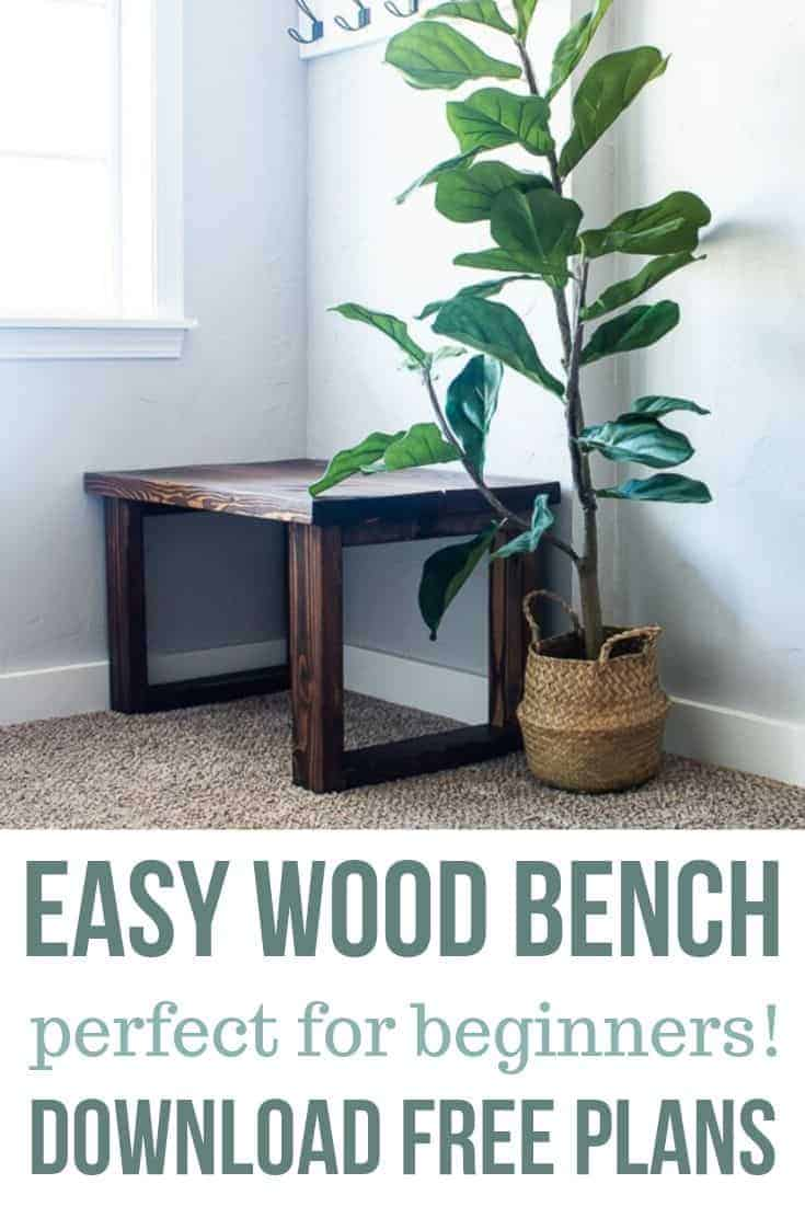 Wood bench on the entryway with a fiddle leaf fig tree on the side with text overlay that says Easy Wood Bench Perfect for Beginners Download Free Plans