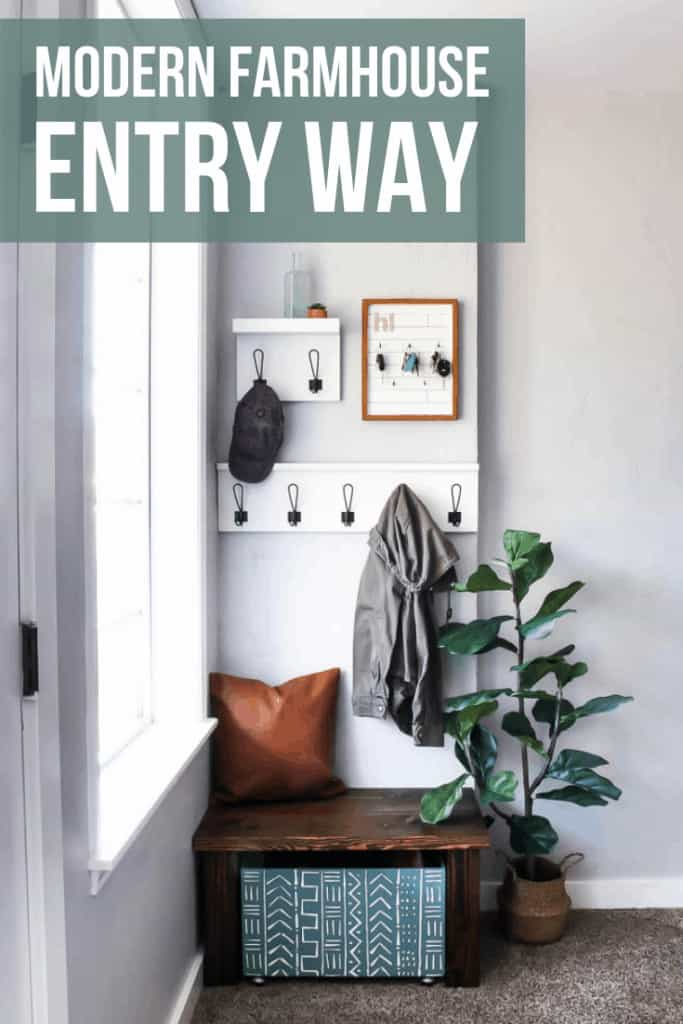 Entryway design which includes coat racks, key holder, leather pillow, wooden bench, wooden shoe storage and indoor plant with text overlay that says Modern Farmhouse Entry Way
