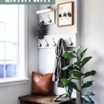 Entryway design which includes coat racks, key holder, leather pillow, wooden bench, wooden shoe storage and indoor plant with text overlay that says Small Corner Entryway