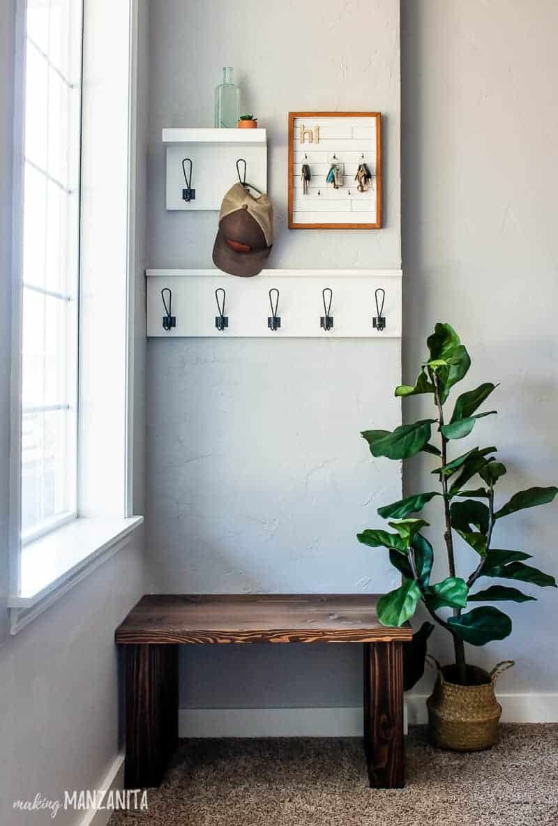 Small entryway with the racks, key holder, DIY bench and an indoor plant