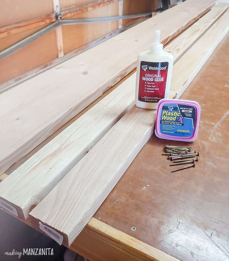 Supplies for DIY bench laying on workbench - wood, wood filler, wood glue