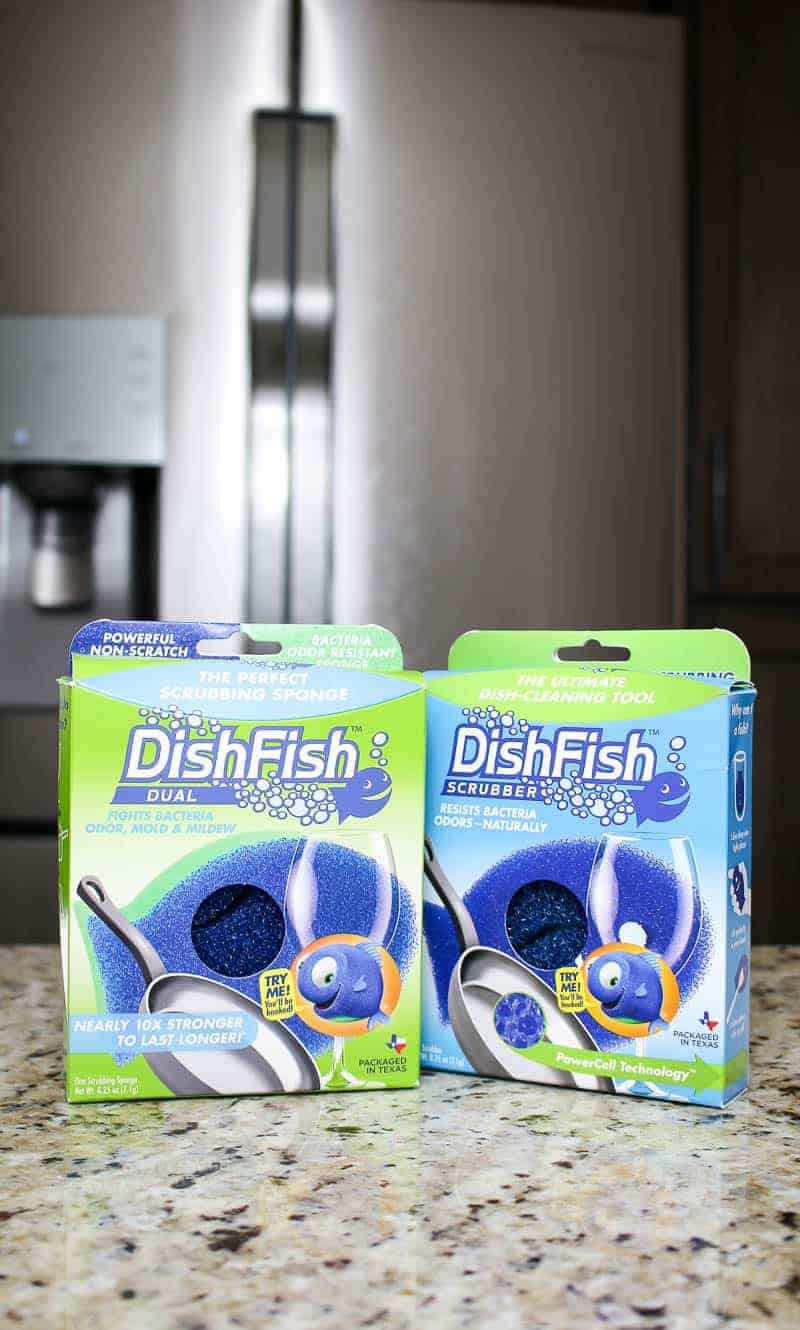 Two DishFish scrubber on the countertop in front of fridge