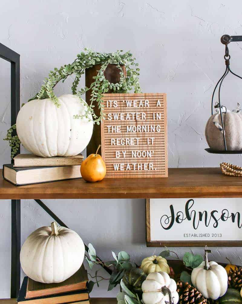 Pumpkin Decorations for Fall beside the letter board, on top of the vintage book and in the wooden dough bowl.