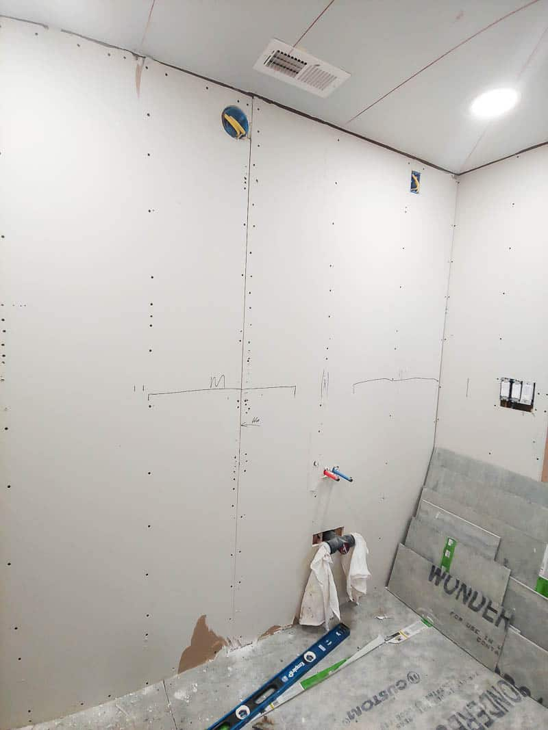 Bathroom wall with plywood ready for drywall attachment.
