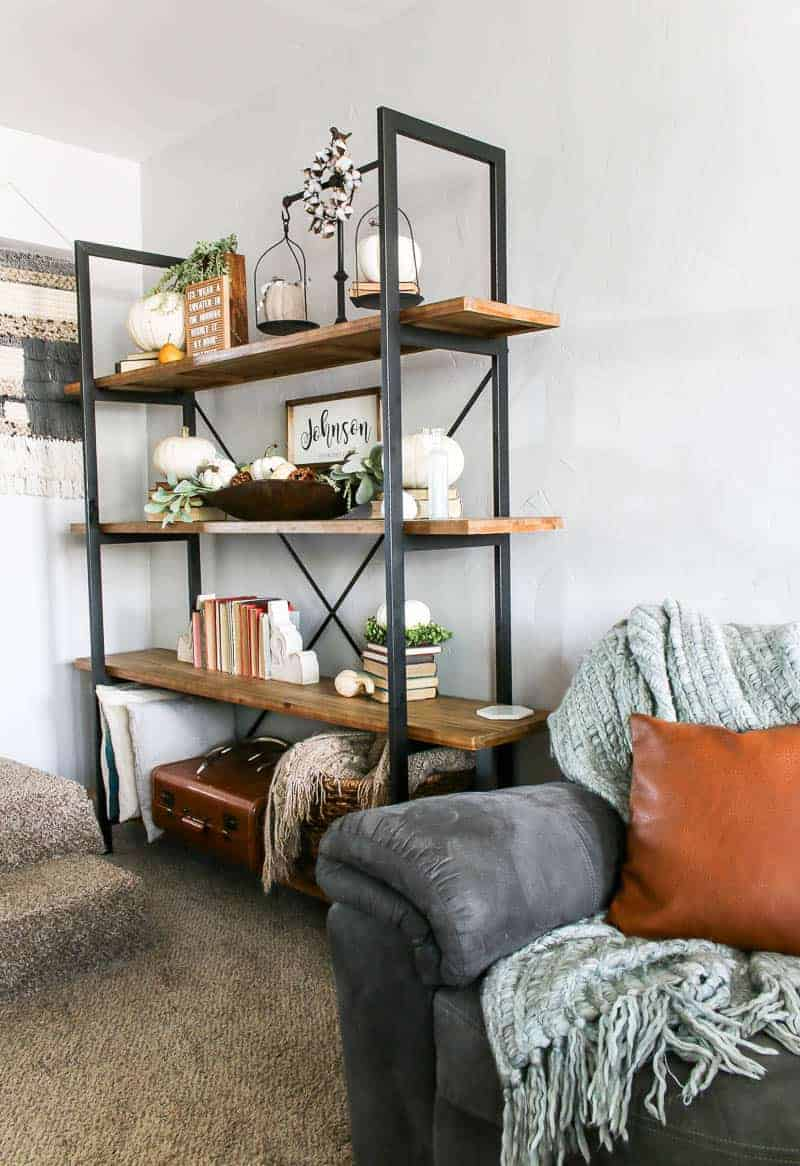 Image of living room shelf with farmhouse decors and white pumpkins decorations for Fall.