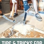 Removing the tile floor using hammer photo with text overlay that says Tips & Tricks For Removing Tile Floors