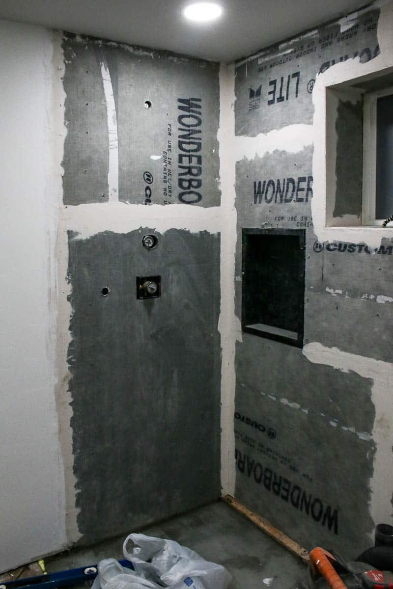 Concrete backer board in shower before tiling during bathroom renovation