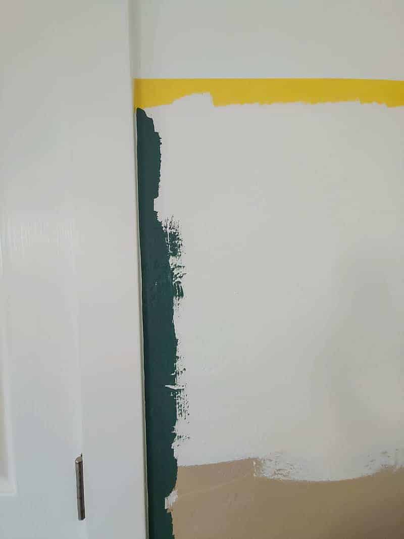 Painting the bottom with color and cutting in around the trim