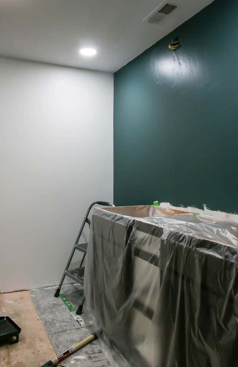 Dark hunter green feature wall in bathroom during a remodel
