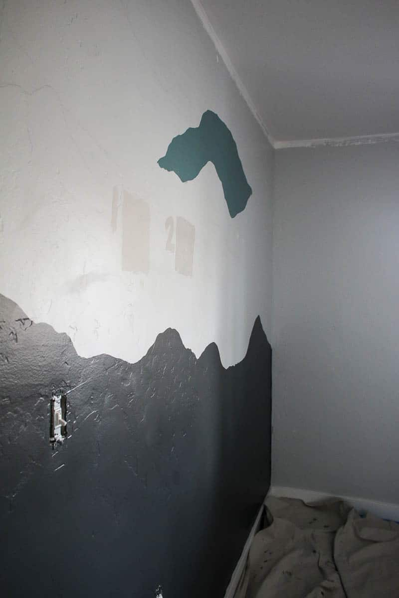 Partially painted wall and 2 more colors at the top of the mountain wall paint
