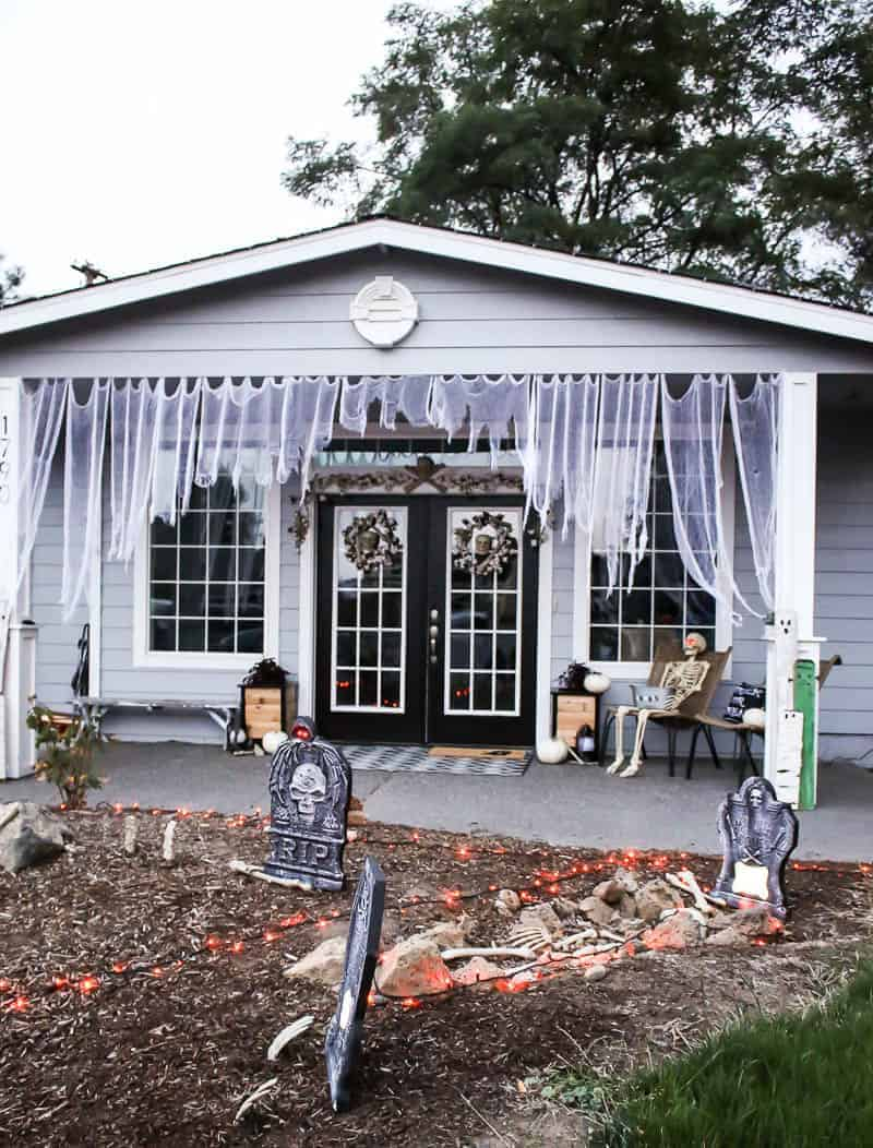 Curtains, Skeleton, fake gravestone, skull wreath for the Halloween Porch Decor