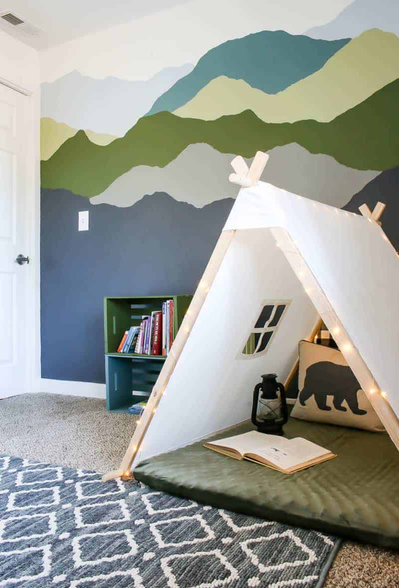woodland boys room with painted wall cozy nook and colorful pallet bookshelves