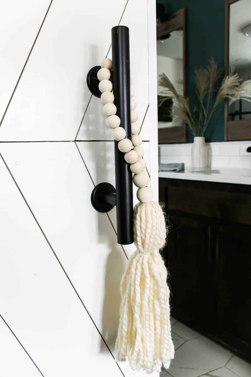 Wooden bead door hanger for the barn door handle