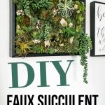 Green succulent wall art with air plants and moss hanging on a white wall with text overlay that says DIY faux succulent vertical garden