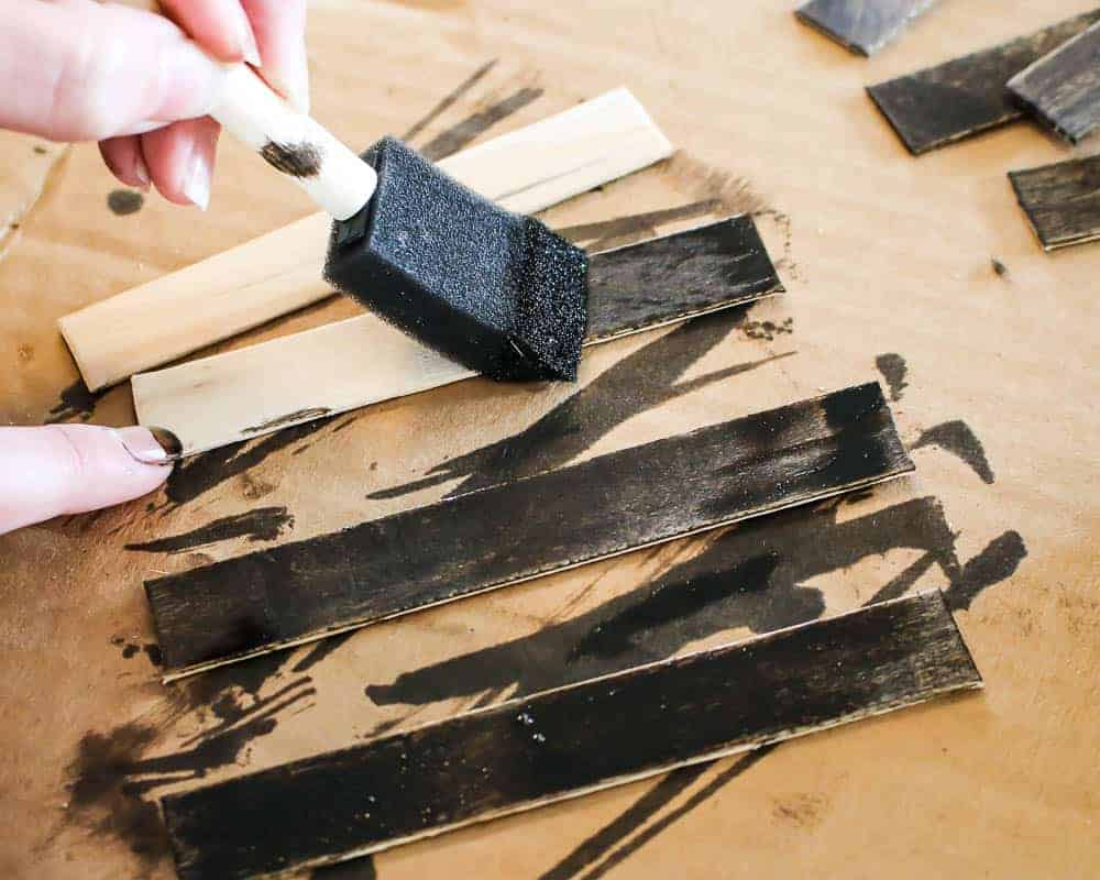 Staining Popsicle sticks using a foam paint brush