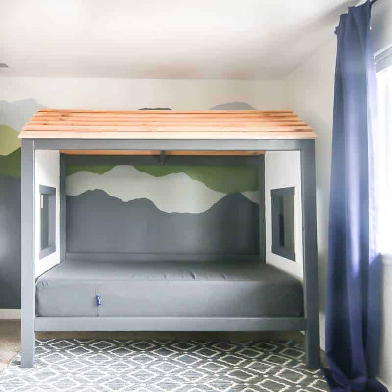 This DIY big kids cabin bed is a perfect fit in our big kids rustic style bedroom.