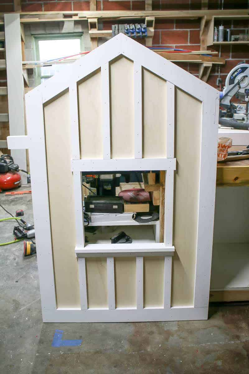 The footboard of this DIY children's cabin bed. This big kids bed is a fun DIY for a rustic and outdoors theme kids room