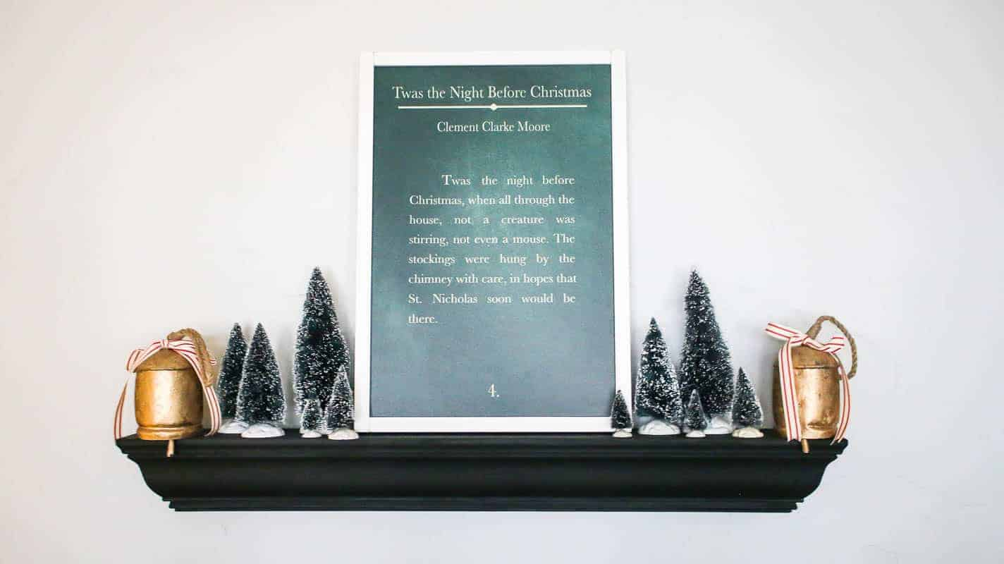 Night Before Christmas farmhouse style sign on top of the wall hang with other Christmas decor like vintage bells and DIY Christmas trees