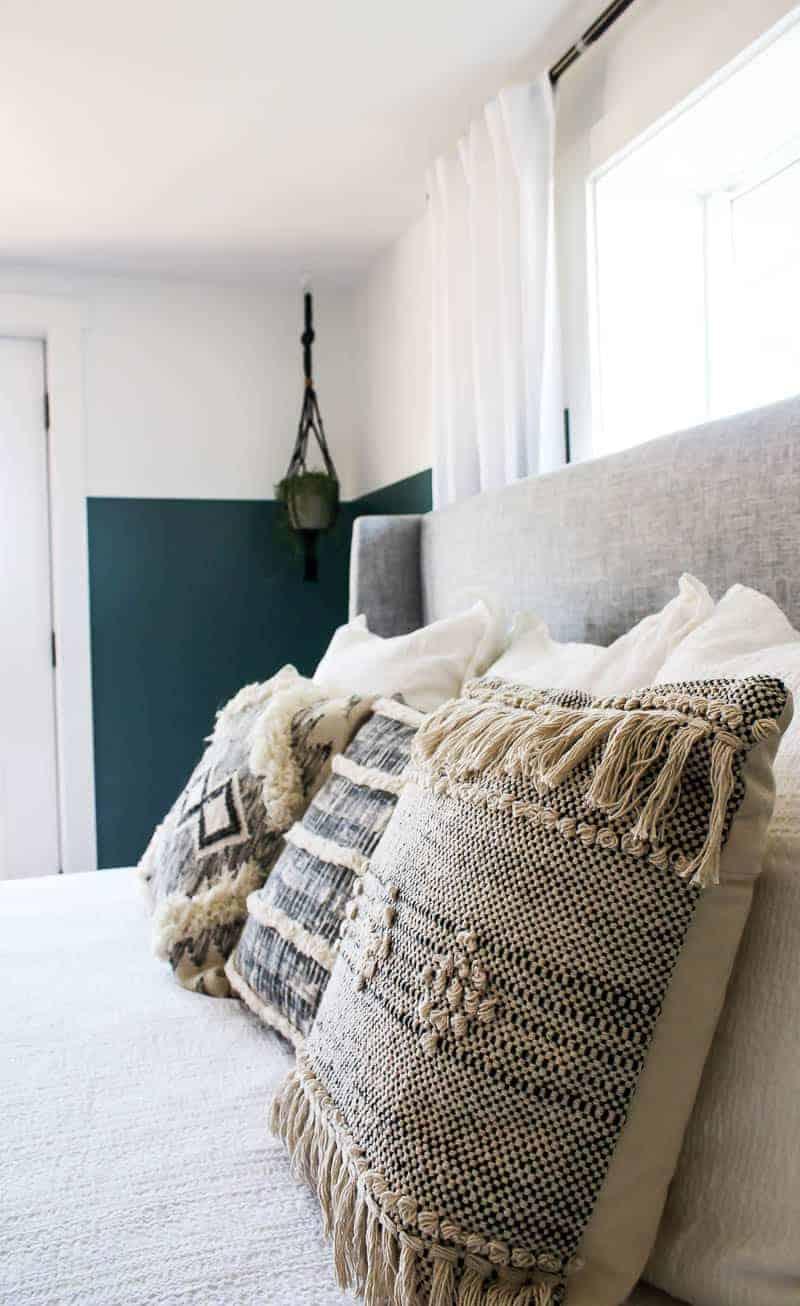 Closer look at the boho throw pillows on top of the bed to complete the modern boho bedroom
