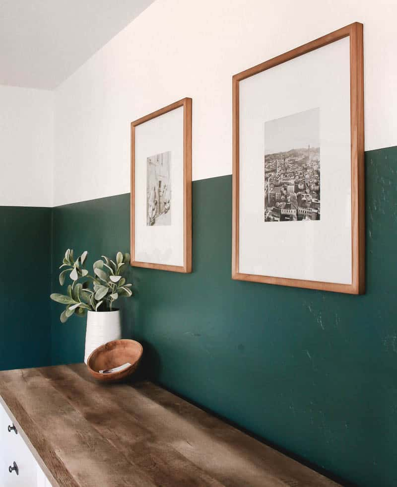 Copper frames with vintage photos and a wooden drawer with indoor plant and coconut shell as decorations