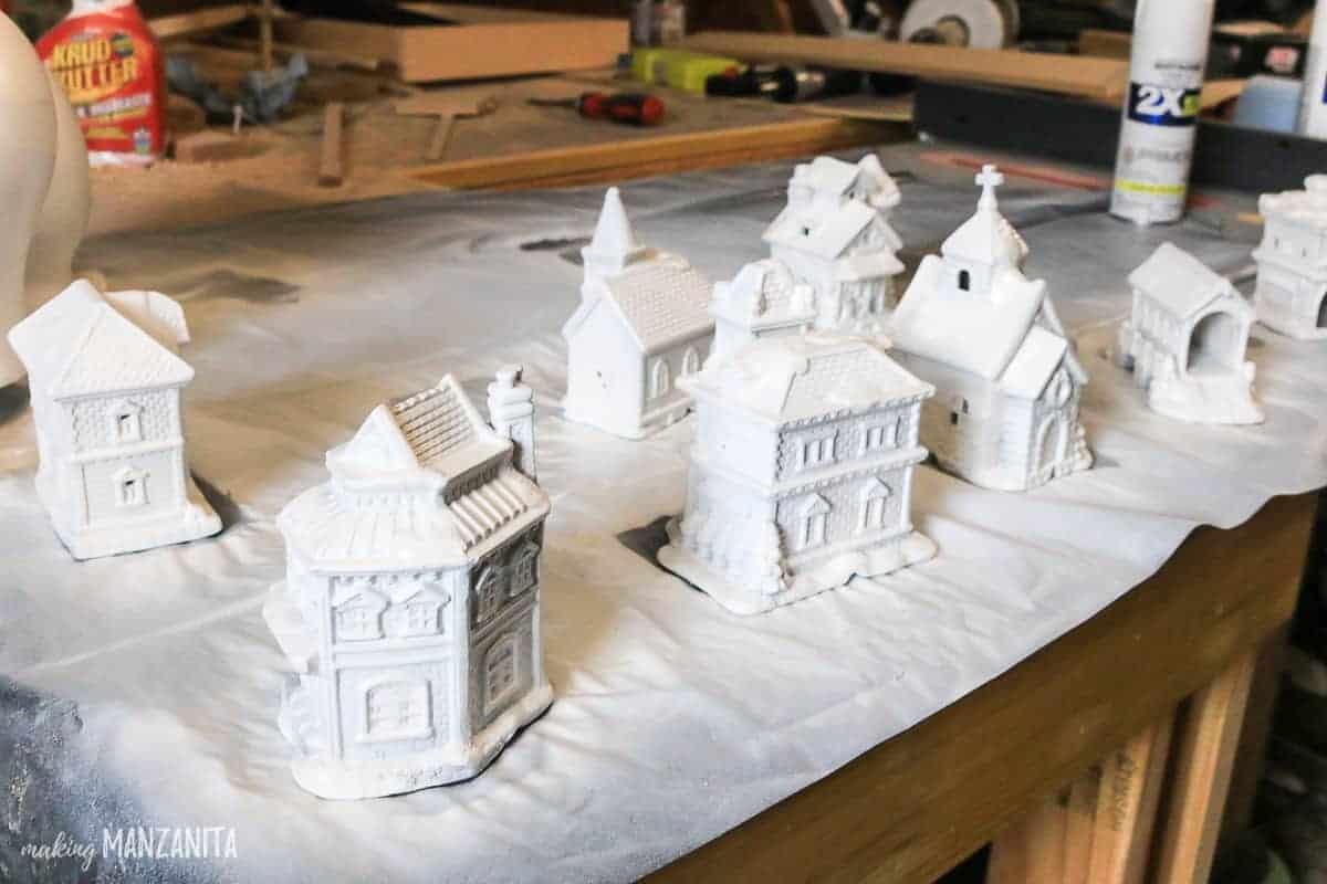 Mini Christmas village buildings spray painted white