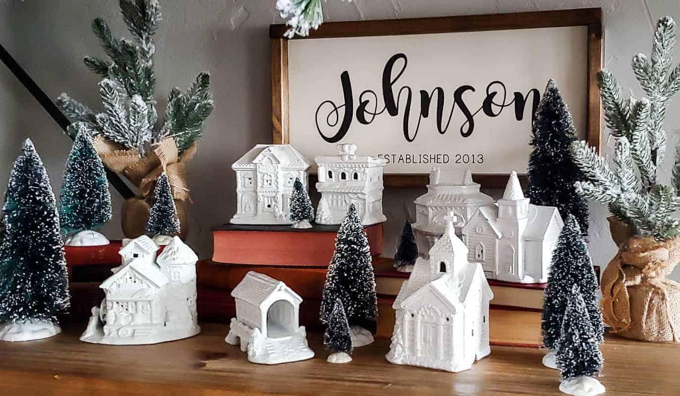 White Christmas Village with mini Christmas trees for the farmhouse Christmas home decor
