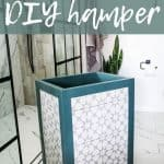 Laundry hamper with teal trim and gray and white tile sitting in a white bathroom with tile flooring and white walls. Text says how to build a diy hamper
