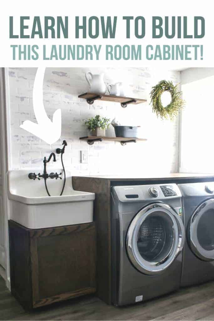"Modern looking farmhouse style laundry room with large farmhouse sink and vintage faucet and sprayer on top of a wood cabinet next to a wood counter top over a washer with white brick walls and wood floors and says ""Learn how to build this laundry room cabinet!"""