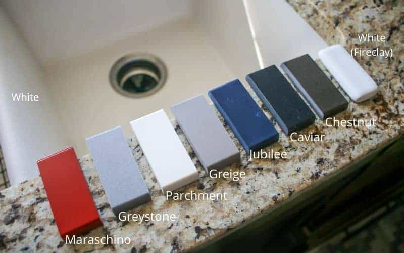 shows a line of the different color samples of quartz in a line on a kitchen sink with labels on each sample