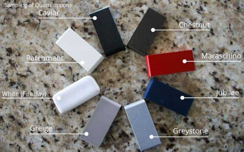 shows a color wheel of the different color sample options for quartz sinks on a granite counter top with labels of each sample name