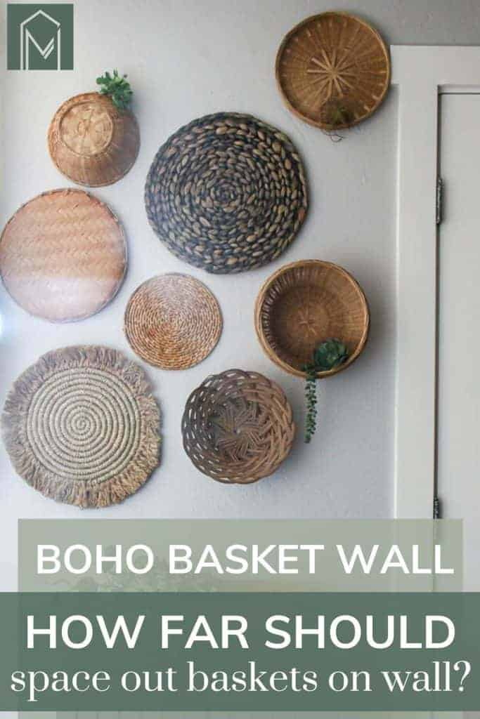 Shows various types of flat wicker baskets with some greenery hanging on the white walls and says boho basket wall, how far should space out baskets on wall