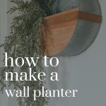 Side view of the modern metal wall planter on a white wall and long green vines hanging from it. Overlay text says how to make a wall planter on a budget