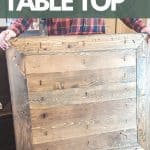 shows a person holding up the top wood part of the table showing pocket hole joinery with overlay texts that says easy to build table top, get the free plans