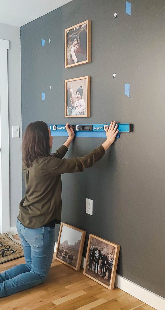 How to create a grid gallery wall using painter's tape, a level, and wood picture frames