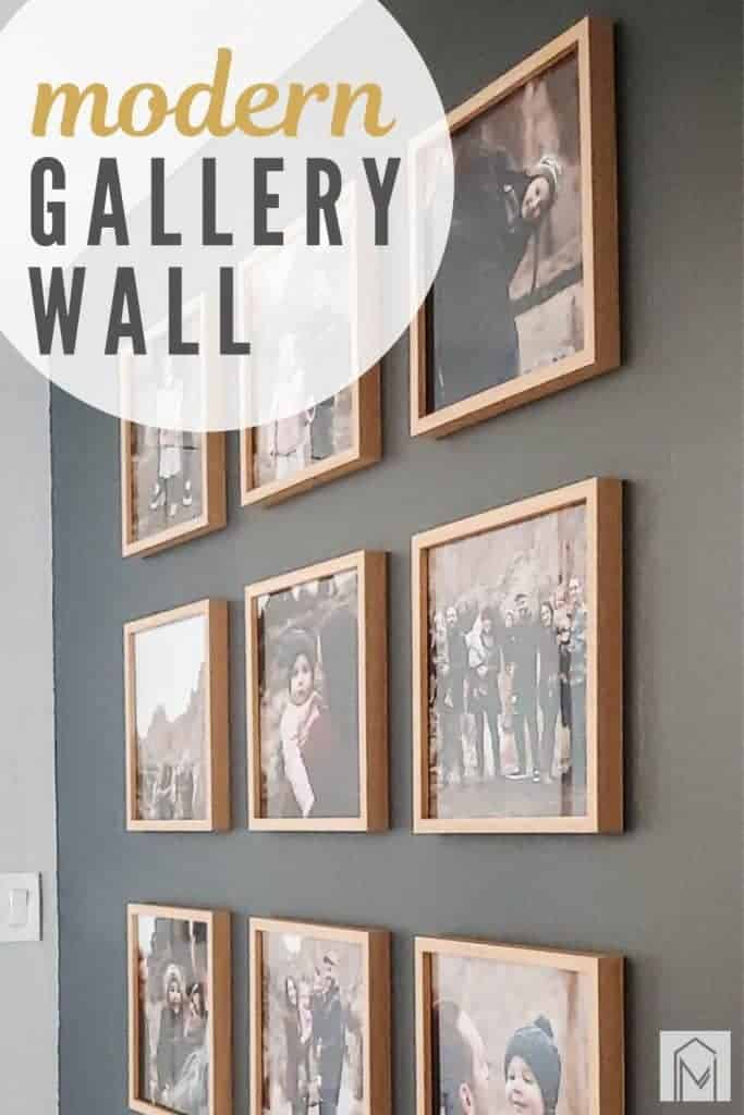 Shows a side angle view of 9 photos in a grid pattern with wood frames on a gray wall with overlay text that says modern gallery wall
