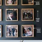 shows family photos hung on a gray wall in a grid pattern with overlay texts that says square grid gallery wall