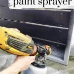 Close up on hand holding a Wagner paint sprayer with the text overlay that says Flexio 3000 Paint Sprayer