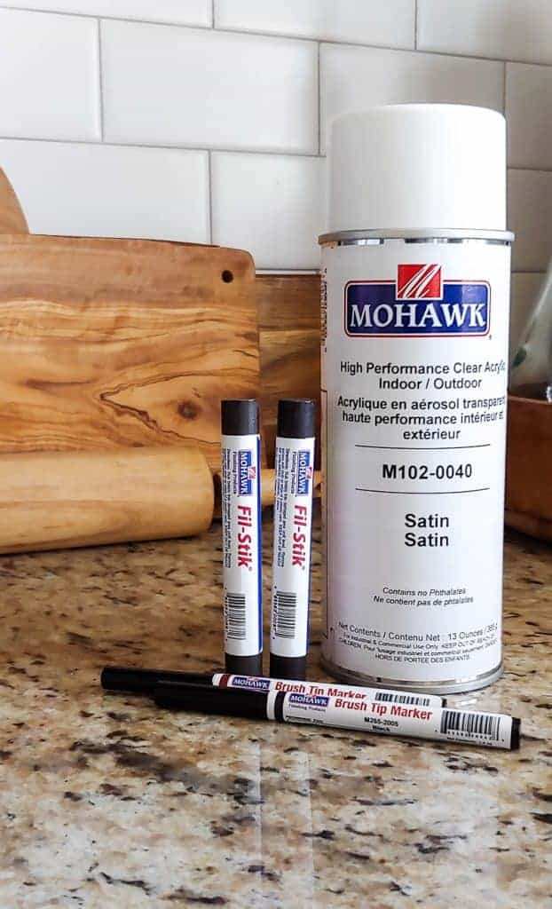 shows Mohawk products such as Fil-Stik, brush tip markers and spray can sealer on a granite counter in kitchen