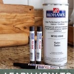shows Mohawk products such as Fil-Stik, brush tip markers, and spray can of acrylic sealer on a granite counter with text at bottom that says learn how to fill holes in wood