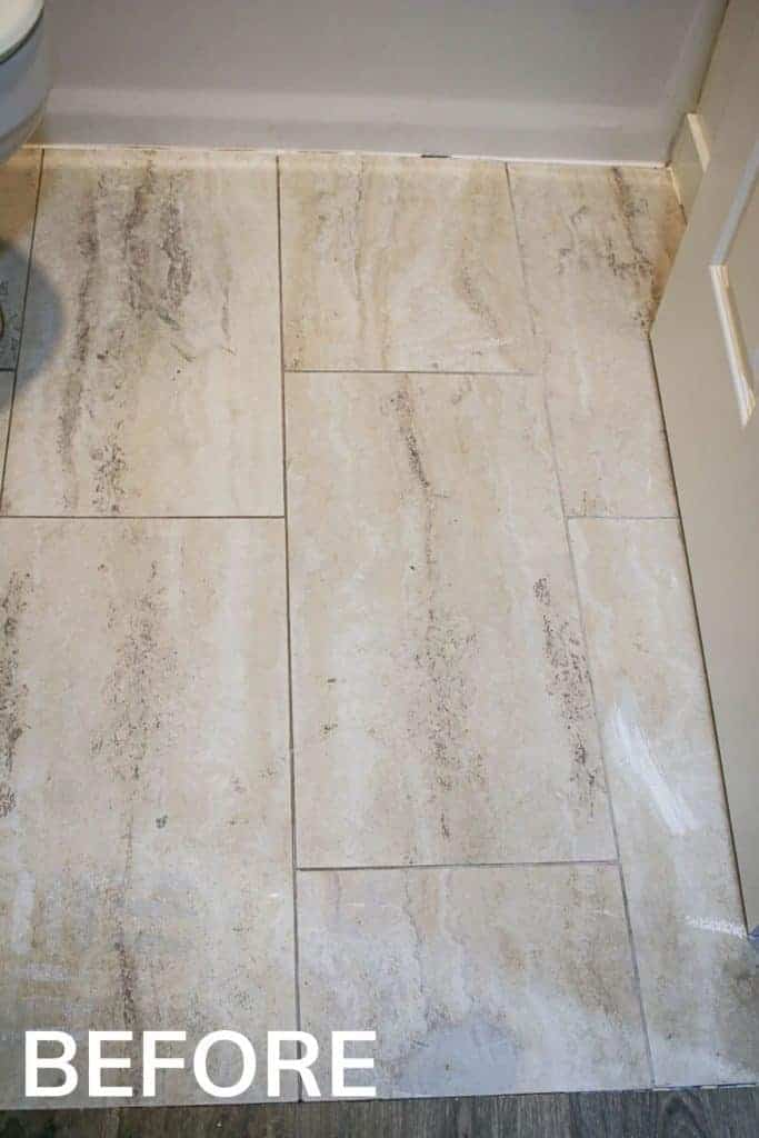 shows an up close view of the tan tile floors in a bathroom