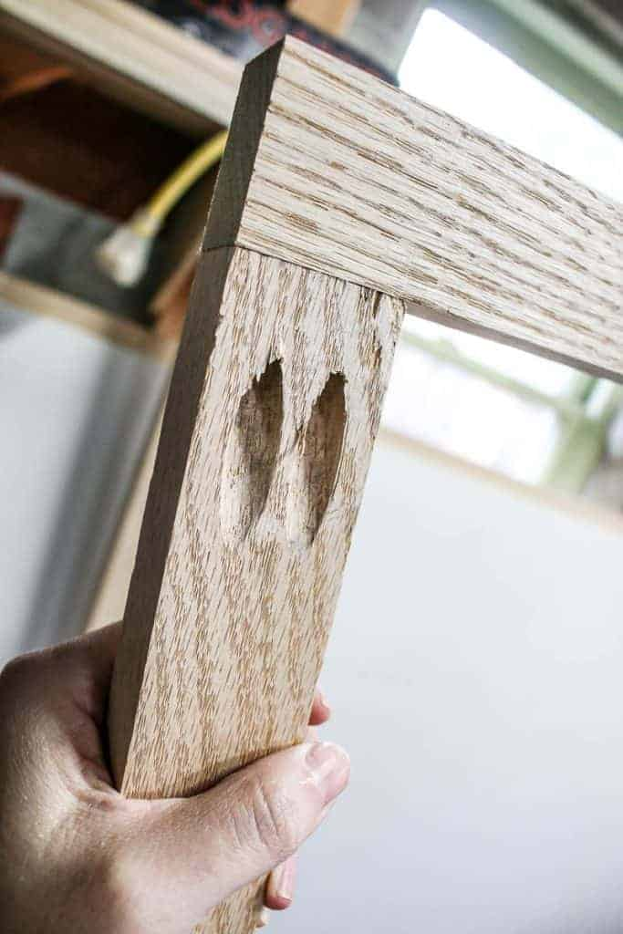 shows two pieces of wood joined together with a couple of pocket holes