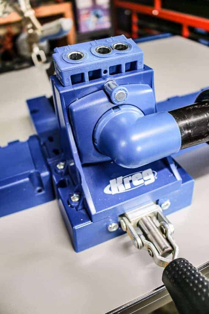shows a up close picture of a blue Kreg Jig K5 system on a table