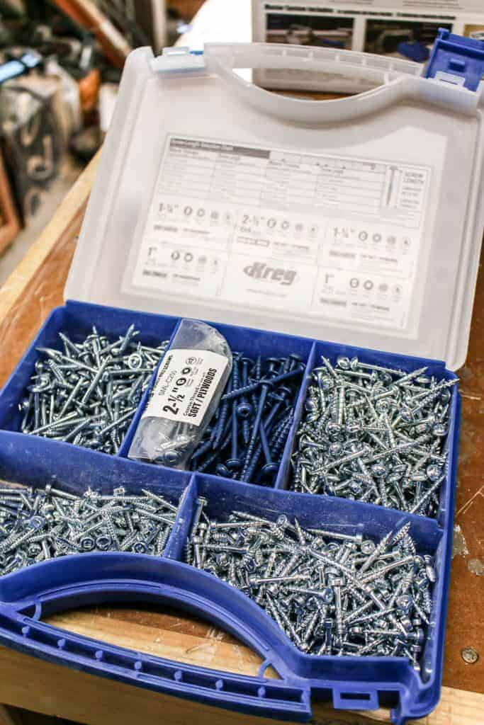 shows a box of 5 different compartments of different Kreg pocket hole screws on a table