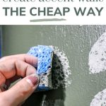 shows an up close picture of a hand stamping a gray painted half circle sponge to a green wall painted with other half circles with text at top that says learn how to create accent walls the cheap way